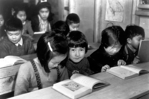 Black and white image of students in classroom
