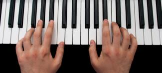 Person playing keyboard
