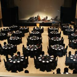 Kobayashi Hall black tablecloth setup with round tables